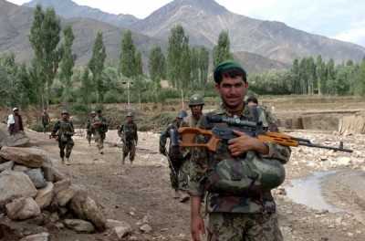 Afghan soldiers patrol in Wardak province, Afghanistan (Aug. 7, 2010); Photo Spc. Theodore Schmidt, U.S. Army
