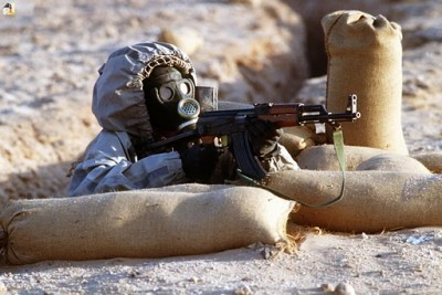 Syrian soldier aims an AK-47; via Wikimedia Commons
