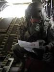 Zadní střelec Chinooku.   Back shooter on board a Chinook chopper.